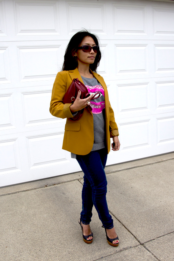 A picture of an outfit styled with yellow blazer and pink lips tee