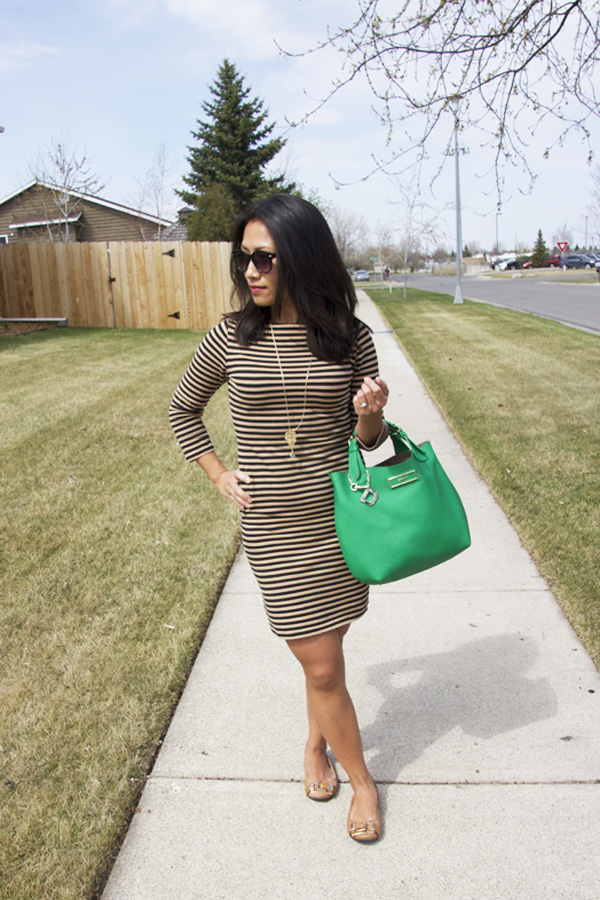 This is a photo of a tan striped t-shirt dress