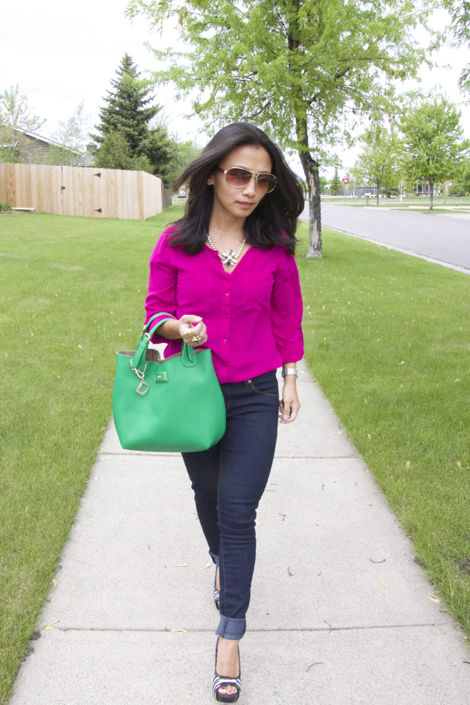 This is a picture of a spring look with hot pink top and skinny jeans