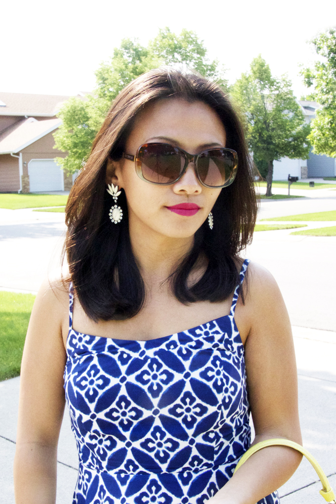 This is a picture of a summer look with blue print sundress.