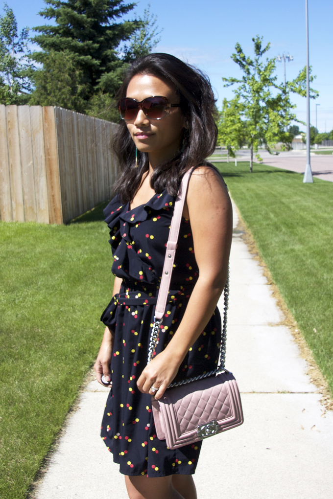 This is a picture of an one piece polka dot dress summer look.