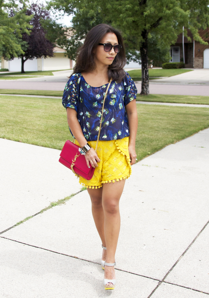 This is a picture of blue printed top and a yellow lace shorts look