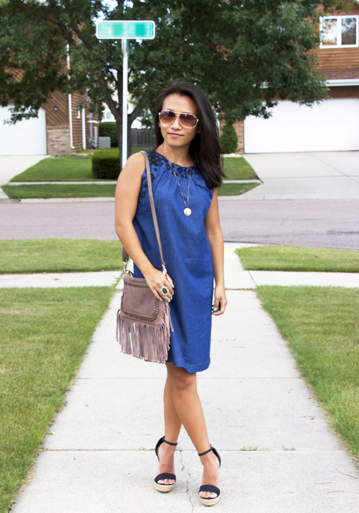 This is a picture of a chambray shift dress summer look.