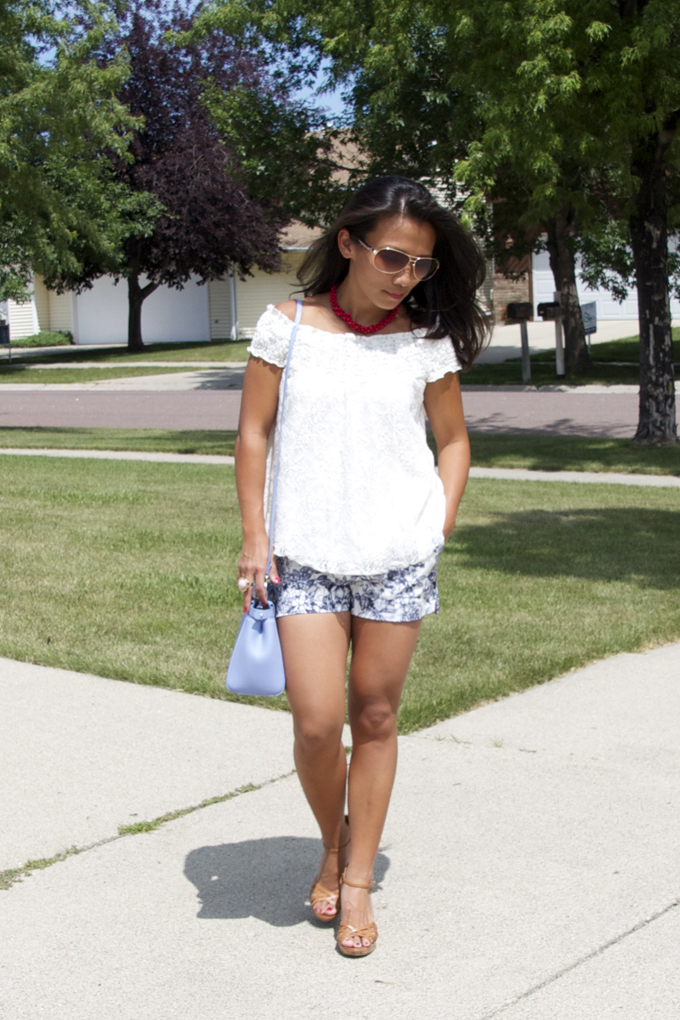 This is a picture of an off shoulder top with shorts look
