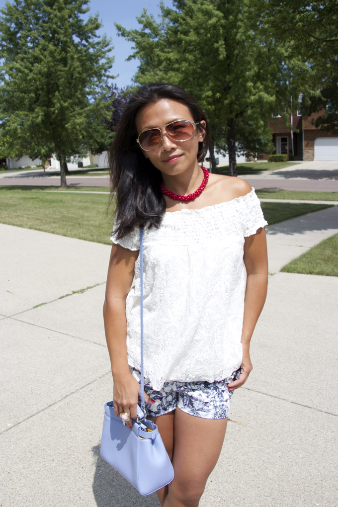 This is a picture of an off shoulder lace top with shorts look
