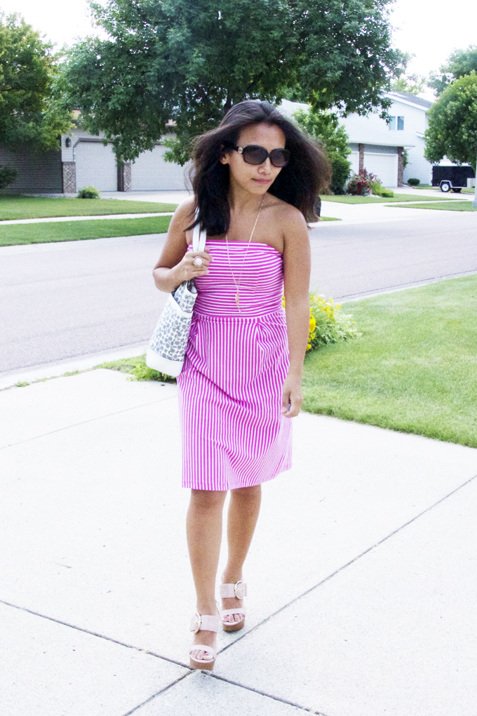 This is a picture of a strapless pink striped dress look.