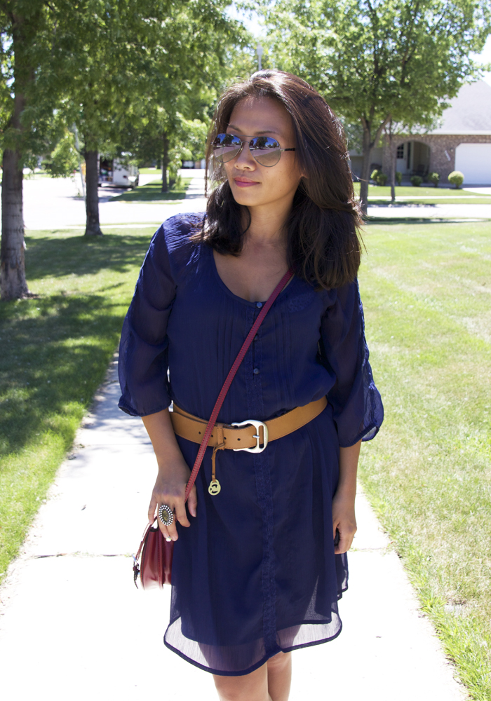 This is a picture of a navy blue long sleeves dress look.