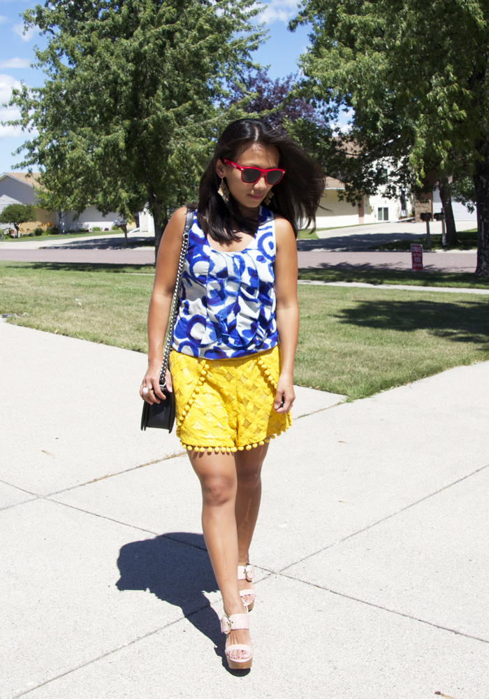 This is a picture of blue print sleeveless top and yellow lace shorts.